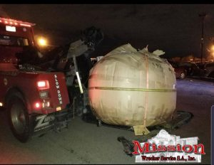 Its a big darn pumpkin sitting on towing company tow truck