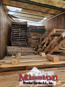 Pallets in Trailer before Schertz Wrecker Service Activities