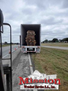 Trailer of Pallets near I10 prior to unloading