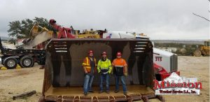 Mission Heavy Towing San-Antonio Team Posing in front of Front Loader