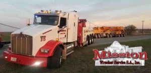Crane Towing Company Heavy Wrecker pulling out crane