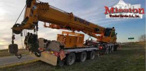Crane leaning prior to help from crane towing company