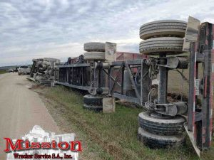 Tractor and trailer on- side before effort by San Antonio Towing