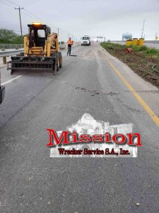 Semi Towing Equipment to-Pull Trailer out of Black Mud