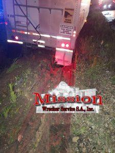 Semi Towing Trailer Stuck in Black Mud
