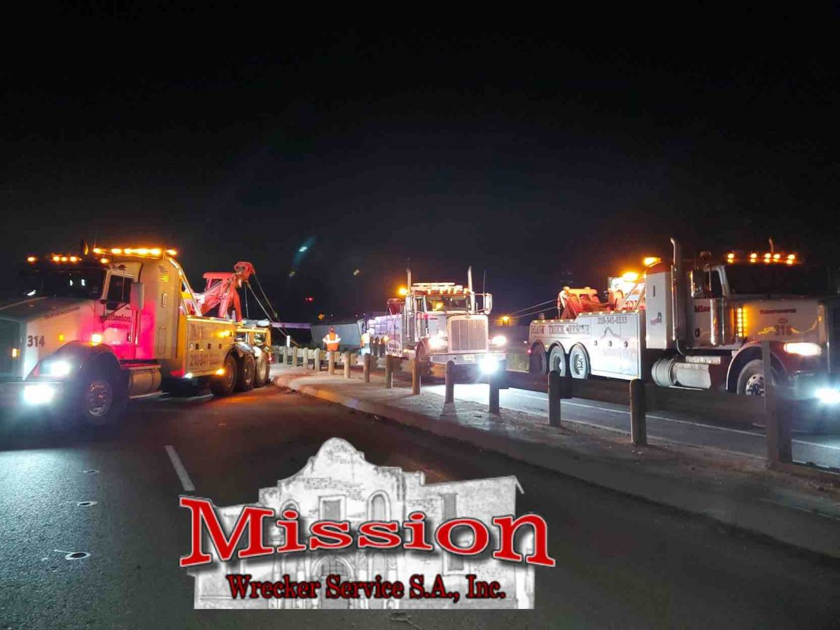 Three Semi Towing Heavy Wreckers Lined Up