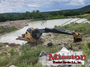 Construction Equipment Tow Firm Makes Muddy Rescue